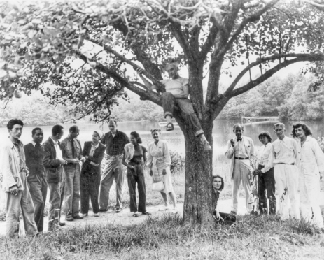 Summer Institute at Black Mountain College, 1946. Left to right: Leo Amino, Jacob Lawrence, Leo Lionni, Theodore Dreier, Nora Lionni, Beaumont Newhall, Gwendolyn Lawrence, Ise Gropius, Jean Varda (in tree), Nancy Newhall (sitting), Walter Gropius, Mary Gregory, Josef Albers, and Anni Albers. Courtesy of North Carolina Office of Archives and History, Raleigh.