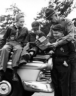 Unidentified NC Highway Patrol personnel, c.1960, with Boy Scouts and Cub Scout. From NC Department of Conservation and Dvelopment, Travel and Tourism photo files, North Carolina State Archives, Raleigh, NC, call #:  ConDev_TID_367_2.
