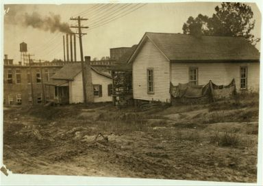 "Some of the housing conditions of the workers in Cannon Mills, Concord, N.C., to contrast with the homes and gardens sometimes shown from the ""show mills"" of the state. Concord, NC, 1912. Image courtesy of the Library of Congress."