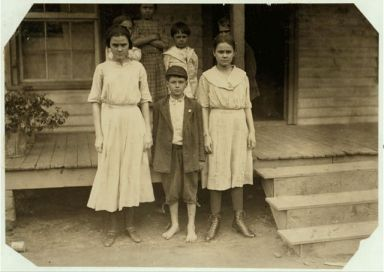 "The three on the ground work in the Cannon Mills, Concord, N.C. The boy ""Otie Honeycott"" (his mother could not spell his name) said he had been doffing two years in the Cannon Mill, Concord, NC, 1912."