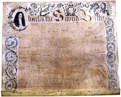 The first page of the Carolina charter of 1663. In the charter, Charles II (shown at upper left) conveyed vast lands extending to the Pacific Ocean and including what is now North Carolina to eight of his supporters, known subsequently as the Lords Proprietors. Courtesy of North Carolina Office of Archives and History, Raleigh.