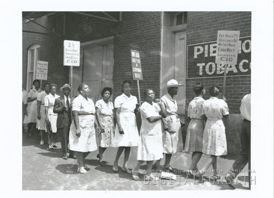 "Jones, Frank. 1946. ""Protest at Piedmont Leaf Tobacco Company, 1946."" Forsyth County Public Library. Call no. FJ.18633. Online at Digital Forsyth."