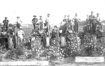 Cotton picking machinery a success; Price Campbell Machines; 2 businessmen and workers pose with 4 machines, near Hamlet, NC, c. 1913; photo by Frank Marchant, Hamlet, NC. From the General Negative Collection, North Carolina State Archives, call #:  N_92_7_31, Raleigh, NC.