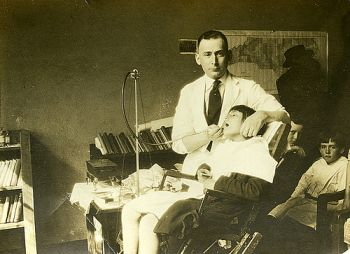 Dr. George M. Cooper with patient  Dental clinic at Badin, NC, Stanly County, 3 march 1921. From the Dr. George M. Cooper Photograph Collection,  North Carolina State Archives, Raleigh, call #:  PhC41_F24_188. NC.