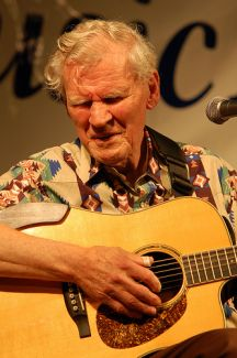 """Doc Watson, 86 years old, plays to the crowd at another fantastic Sugar Grove Music Fest.."" Image courtesy of Flickr user Joe Giodorno, taken on July 11, 2009."