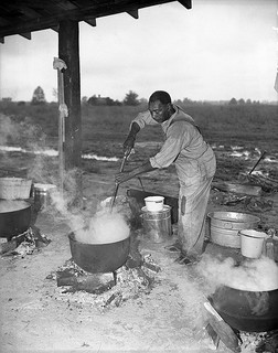 Fish stews are usually cooked outside in a cast-iron pot. Image courtesy of Conservation and Development Department, Travel and Tourism Photo Files, North Carolina State Archives, call #: ConDev4650.5B, Raleigh, NC.
