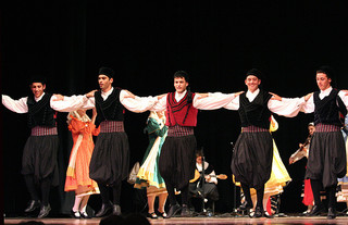 Dancers from Greece performing on stage, Folkmoot, 2009. Image courtesy of Flickr user anoldent.