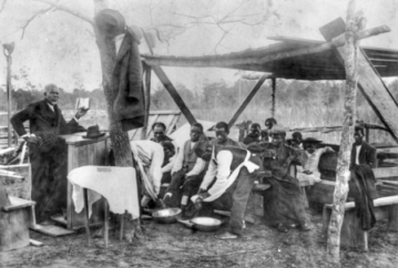 View of a foot washing ceremony at the Mount Ronius Free Will Baptist Church at Lake Waccamaw, ca. 1910. North Carolina Collection, University of North Carolina at Chapel Hill Library.