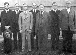 The first faculty included (l to r) William P. Few, Elbert Russell, Paul Neff Garber, James Cannon III, Dean Edmund D. Soper, Howard M. LeSourd, and Allen H. Godbey. Harvie Branscomb was absent for the photo. Courtesy of Duke Divisity Magazine.