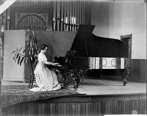 Unidentified girl playing piano at Peace or Meredith College, Raleigh, NC, probably 1910s. From the Barden Collection, North Carolina State Archives, call #:  N.53.16.4348.