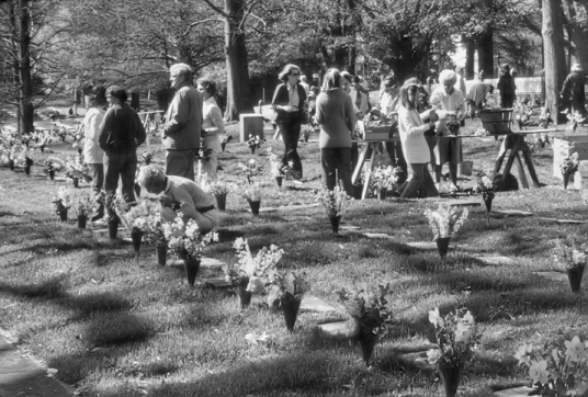 Members of the Moravian congregation tend to the graves in God's Acre at Home Church in Old Salem, some of which date from the eighteenth century. Photograph by Billy E. Barnes, Chapel Hill.