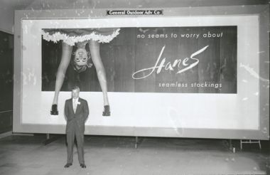 """Gordon Hanes, of Hanes Corporation, in front of a Hanes Hosiery billboard, 1956."" Image courtesy of DigitalForsyth."