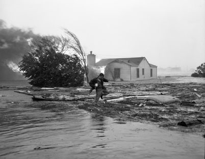 """Julian Scheer wading through debris after Hurrican Hazel (1954), Carolina Beach, NC.""  Image courtesy of UNC Libraries."