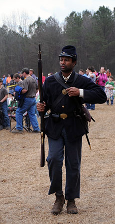 Photograph depicting an African American soldier in the Union Army, taken at a North Carolina Civil War battle re-enactment. Image used courtesy of the North Carolina Department of Natural and Cultural Resources.