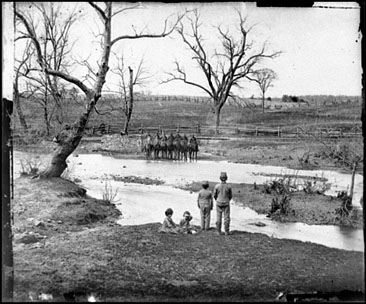 Children watching soldiers at Sudley Ford, Virginia in what would become the Battle of Bull Run.  Photograph, March 1862 by George Barnard.  From the Civil War Glass Negatives Collection, Library of Congress.