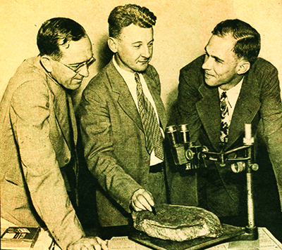 A photograph of professors (l to r) James G. Lester, Haywood Pearce, Jr., and Ben W. Gibson examining the first Dare Stone. Image courtesy of Brenau University, Gainesville, Ga.