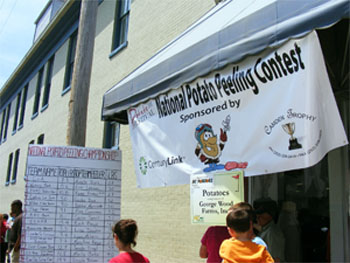 Photograph of the National Potato Peeling Contest at the Elizabeth City Irish Potato Festival.  By Ajsanjua CC BY-SA 3.0, from Wikimedia Commons.
