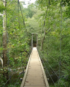 """Eno Park Footbridge,"" by Zanter, 2006.  At the Eno River State Park, North Carolina.  From Wikimedia Commons, used under Creative Commons license CC BY-SA 3.0."
