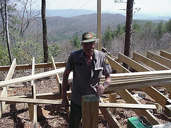 Park staff building a structure with a scenic view behind the work site, Gorges State Park. Photograph, April 11, 2001. North Carolina Division of Parks and Recreation.
