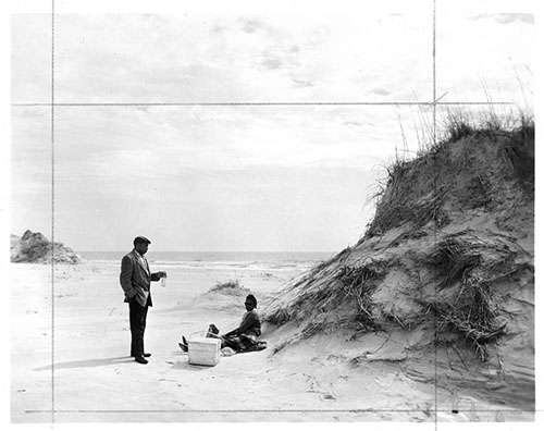 Civil and human rights activist C. Payne Lewis and Freddie Hill Lewis picknicking at Hammocks Beach, 1950s. From the North Carolina State Parks Collection, NC Digital Collections. Prior permission of the Division of Parks and Recreation required for any commercial use.