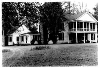 Black and white photograph of Long Valley Farm, ca. 1993. From the National Park Service National Register of Historic Places registration form for Long Valley Form, 1993.  Today the farmhouse and property form a portion of Carvers Creek State Park.