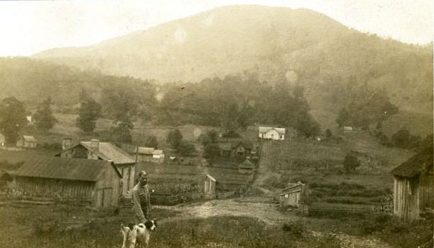 "Photograph of a small farming community in Jefferson, N.C. with Mount Jefferson in the distance, ca. 1920.  The mountain was given the name ""Mount Jefferson"" at the time the park was created in 1956. Item H.19XX.313.27 from the collection of the N.C. Museum of History."