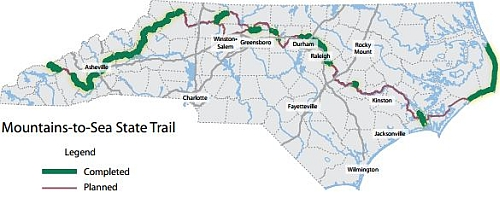 Map illustration of the N.C. Mountains-To-Sea State Trail, with existing trail segments shown in green and planned portions shown in red. From <i>North Carolina State Parks Naturally Wonderful</i>, North Carolina Division of Parks and Recreation, December 2013.</a> NC State Documents Collection, NC Digital Collections.