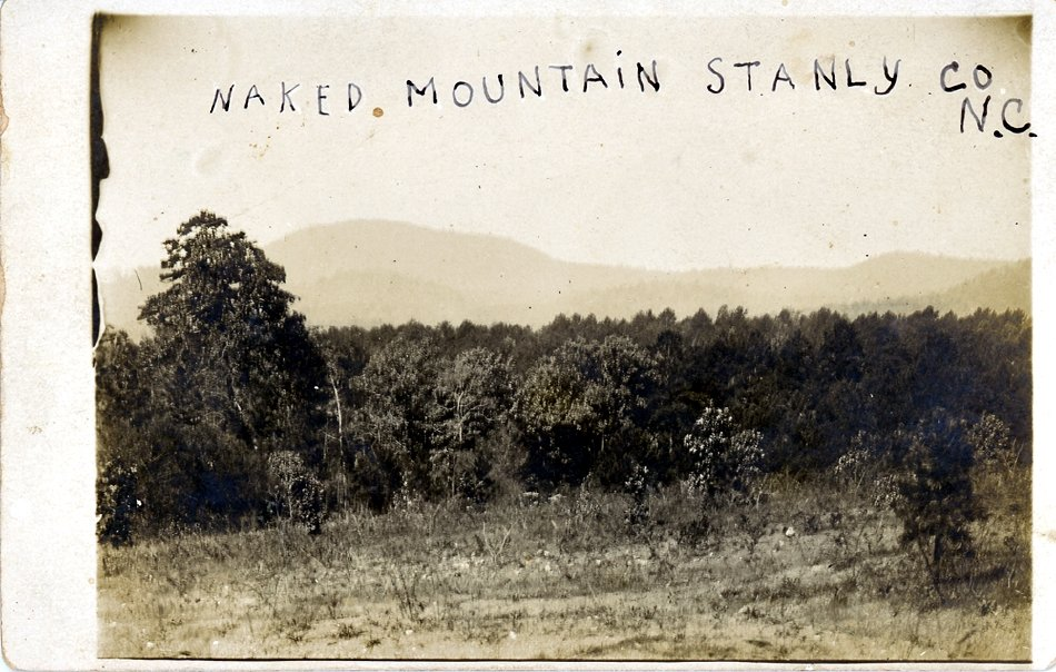 """Naked Mountain Stanly Co N.C."" Photograph ca. 1920s. For a time the mountain was called Naked Mountain, named for its appearance following timber loss during a hurricane of February 1884. The mountain was subsequently renamed ""Morrow"" for James Morrow who later purchased the land. From the collection of the Stanly County Museum, Albemarle, N.C."