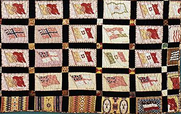 "Closeup of center medallion style quilt made with ""Flags of the World"" and ""Indian Blankets"" flannel advertising inserts from American Tobacco Company,  made ca. 1915, Durham County, N.C. From the collections of the North Carolina Museum of History, used courtesy of the North Carolina Department of Cultural Resources."