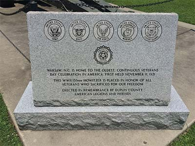 Photograph of the granite monument at the Duplin County Veterans Howitzer monument, Warsaw, N.C.  The marker acknowledges the first annual occurrence of the Warsaw parade on November 11, 1921.  Photograph courtesy of Commemorative Landscapes of North Carolina.
