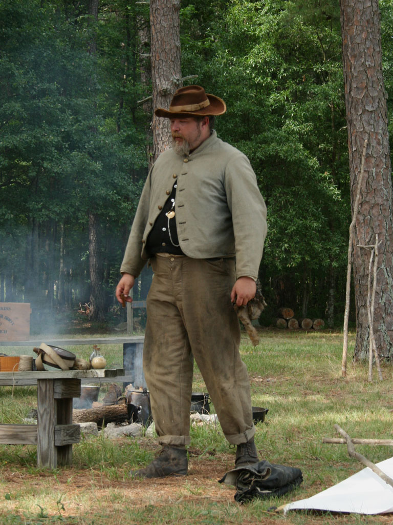"A Confederate reenactor in a ""butternut"" uniform. Northern soldiers called Confederates ""butternuts"" because of the tan-grey color of the uniforms."