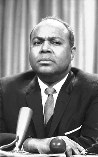 This is a photograph of James Farmer, one of the leaders of the civil rights movement, at a meeting of the American Society of Newspaper Editors in 1964.