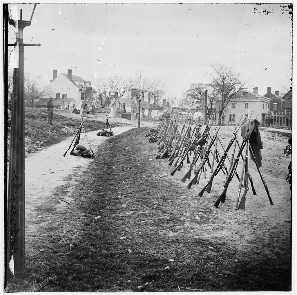 In Petersburg, Virginia, a row of Union rifles stand stacked against each other.