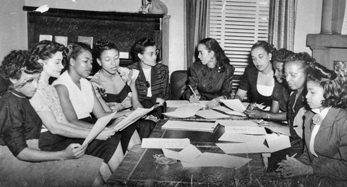 A meeting of the Phyllis Wheatley YWCA in Charlotte, ca. 1940s. Founded in 1916, the Phyllis Wheatley Branch was the first African American YWCA branch in the United States. Photograph courtesy of Floretta Douglas Gunn. Carolina Room, Public Library of Charlotte and Mecklenburg County.