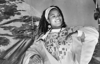 Dancer at the Community Village on South State Street during a Kwanzaa celebration in Raleigh, 17 Dec. 1999. Photograph by Bernard Thomas. Durham Herald-Sun.