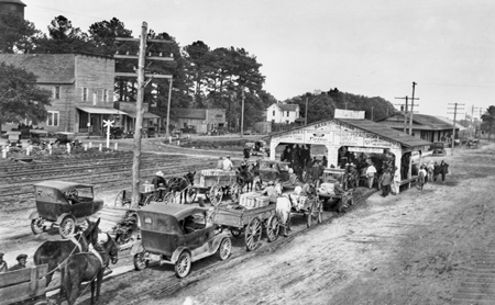 Farmers line up to sell strawberries at the market in Chadbourn, a traditional center for production of the crop in North Carolina, ca. 1920. North Carolina Collection. University of North Carolina at Chapel Hill Libraries.