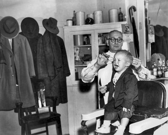 A North Carolina barber at work (date unknown). Courtesy of North Carolina Office of Archives and History, Raleigh.