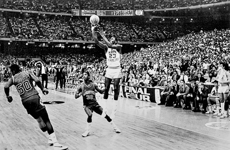Michael Jordan, as a UNC freshman, launches the winning shot against the Georgetown Hoyas in the 1982 NCAA championship game in New Orleans. Photograph by Allen Dean Steele. Raleigh News and Observer.