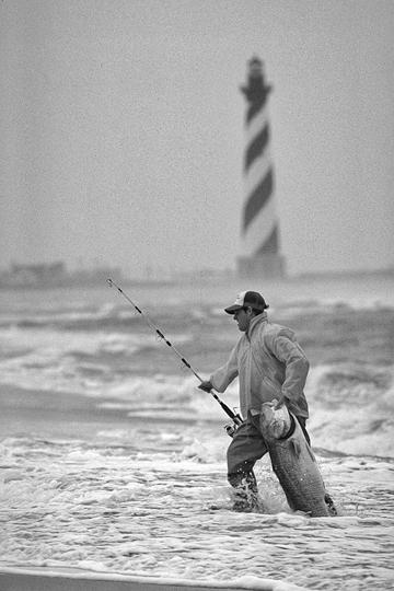 Fishing in the surf near Cape Hatteras Lighthouse. Photograph courtesy of North Carolina Division of Tourism, Film, and Sports Development.