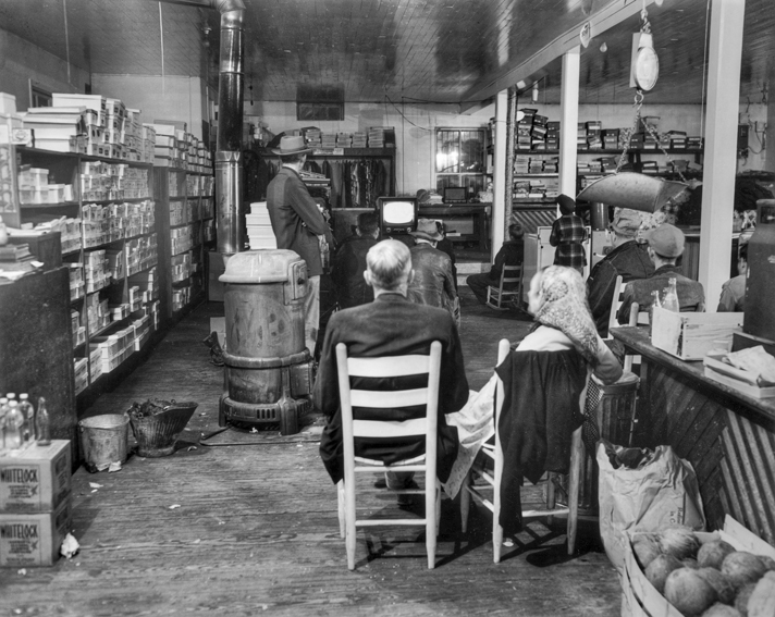 Cary Durham store in Bynum, 1952. People have gathered to watch one of the first television sets in the community. Photograph by Roland Giduz. North Carolina Collection, University of North Carolina at Chapel Hill Library.