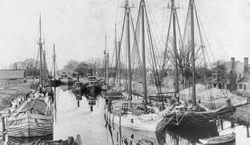 A view of the Dismal Swamp Canal at South Mills, ca. 1900. North Carolina Collection, University of North Carolina at Chapel Hill Library. (Click to view larger.)