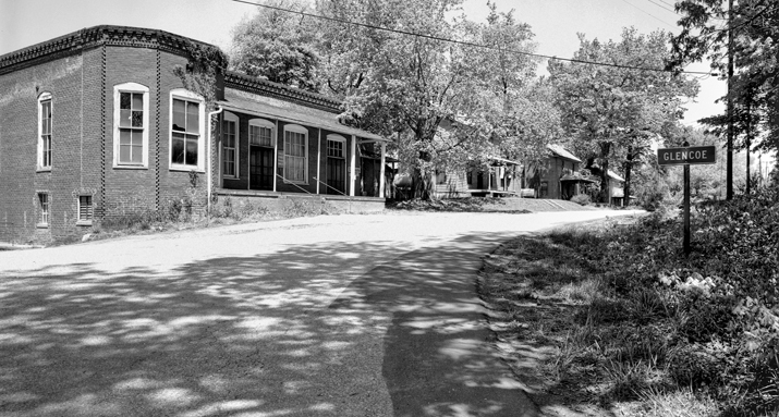 The company store (left) and houses along a street in Glencoe, 1978. Courtesy of North Carolina Office of Archives and History, Raleigh.