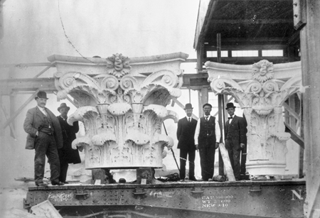 Italian master carvers were employed at the Mount Airy Granite Company in the early 1900s; here, column capitals they have crafted are loaded on a railroad car. North Carolina Collection, University of North Carolina at Chapel Hill Library.
