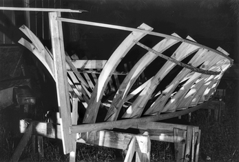 Boat in the early stages of construction at the Lewis Brothers boat works on Harkers Island, 1992. Copyright Edwin Martin, 1992. North Carolina Collection, University of North Carolina at Chapel Hill Library.