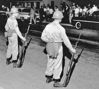 National Guardsmen face off with townspeople in Henderson after being mobilized by Governor Luther Hodges during the Harriet-Henderson Mills strike in May 1959. Courtesy of North Carolina Office of Archives and History, Raleigh. The Raleigh News and Observer files.