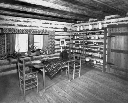 The dining room in the home of Jacques and Juliana Busbee at Jugtown, showing pieces of their pottery. Courtesy of North Carolina Office of Archives and History, Raleigh.