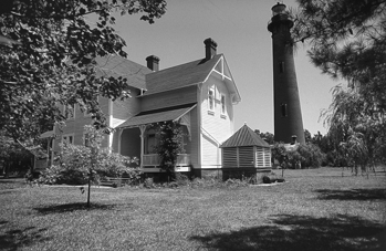 Currituck Beach Lighthouse and keeper's residence at Corolla. Photograph courtesy of North Carolina Division of Tourism, Film, and Sports Development.