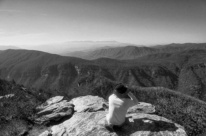 A hiker surveys the horizon from the edge of Linville Gorge. Photograph courtesy of North Carolina Division of Tourism, Film, and Sports Development.
