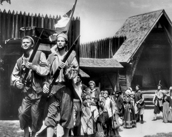 Roanoke colonists leave Fort Raleigh at the climax of Paul Green's dramatic recreation of their story in The Lost Colony. Photograph by Aycock Brown. North Carolina Collection, University of North Carolina at Chapel Hill Library.