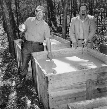 Law enforcement officers test the evidence during a raid on an illegal liquor distillery in the Eno Township of Orange County in 1958. Photograph by Roland Giduz. North Carolina Collection, University of North Carolina at Chapel Hill Library.